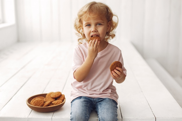 Cute child eating cookies