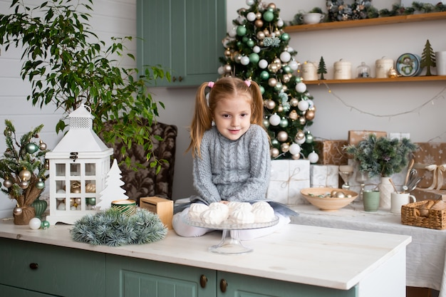 Cute child having fun in kitchen at home
