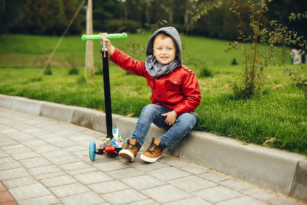 Cute child in a park playing on a grass