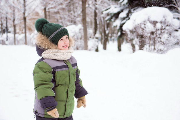 Cute child playing in a snow
