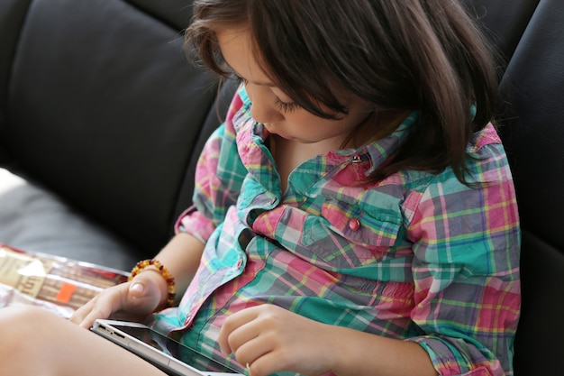 Cute child using tablet