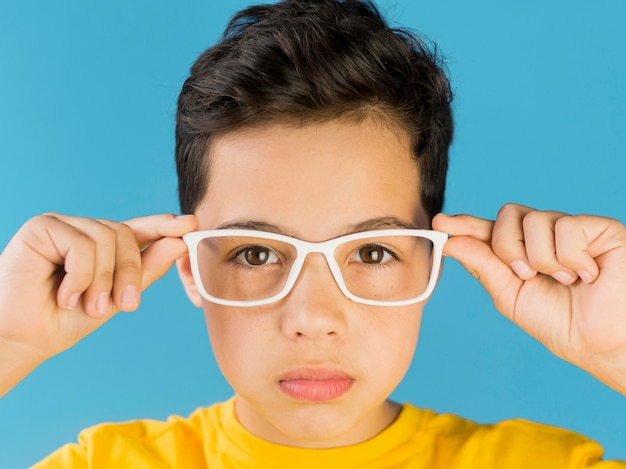 Cute child wearing fake glasses portrait