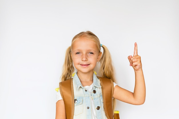 Cute child on white background. kid with backpack.