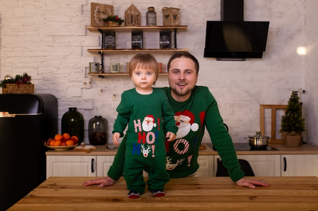 Cute child with father in kitchen at home