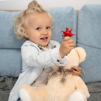 Cute child with toy at home during quarantine
