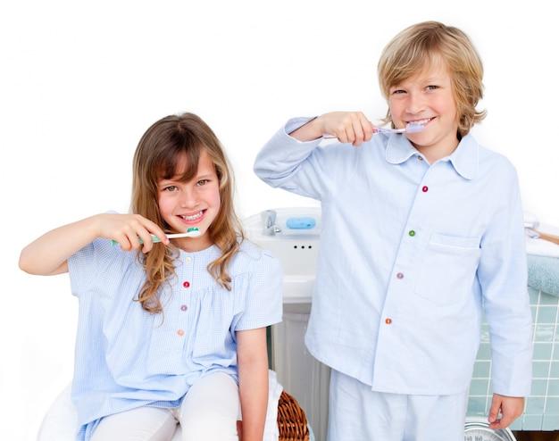 Cute children brushing their teeth