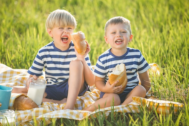 Cute children drinking milk and eating bread