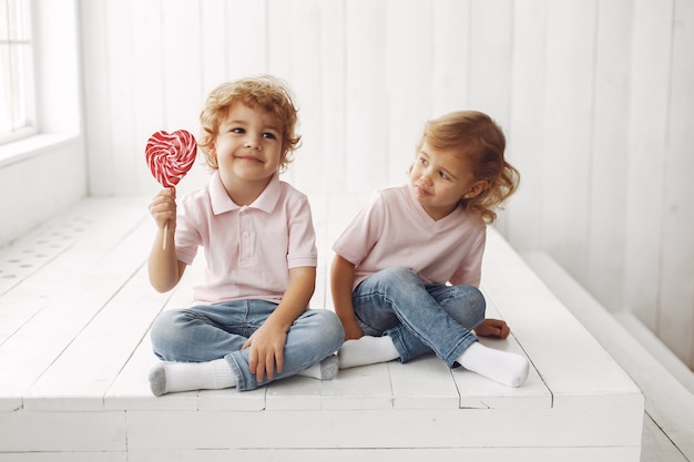 Cute children having fun with candy