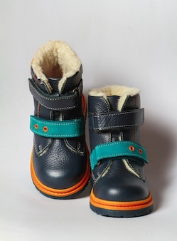 Cute children's autumn boots isolate on a white background