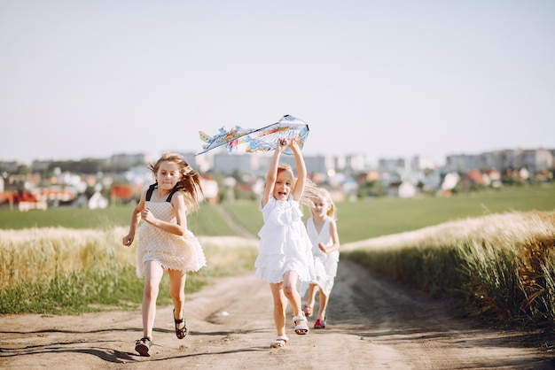 Cute children spend time on a summer field