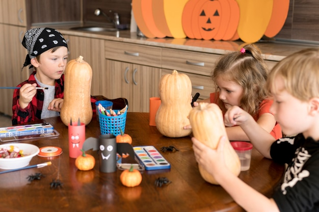 Cute children with pumpkins halloween concept