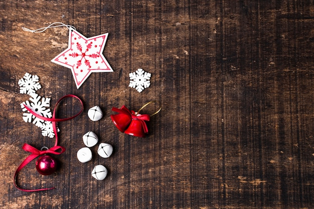 Cute christmas ornaments on wooden background with copy space