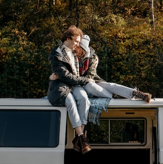 Cute couple being close while sitting on a van