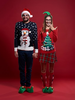 Cute couple in christmas clothes isolated