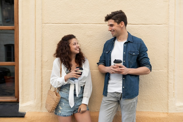 Cute couple enjoying a cup of coffee outdoors