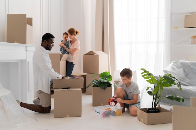 Cute couple getting ready to move with their children