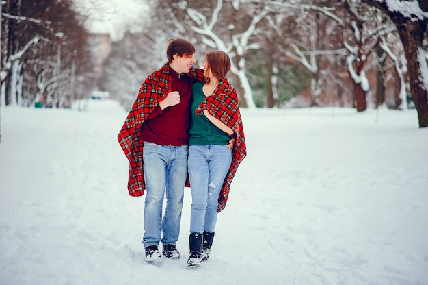 Cute couple have fun in a winter park