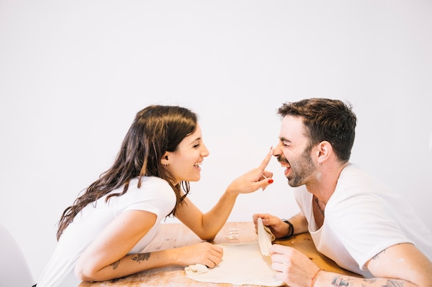 Cute couple having fun at table