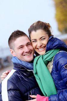 Cute couple having a good time outside