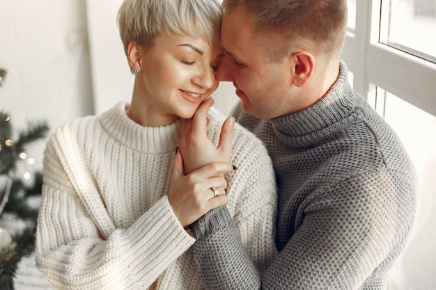 Cute couple at home. lady in a white sweater.