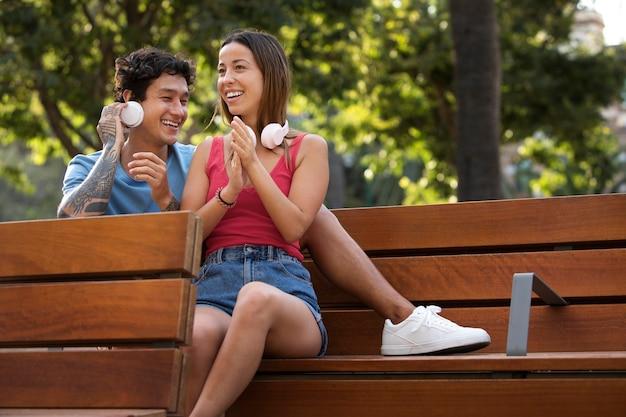 Cute couple listening to music on headphones