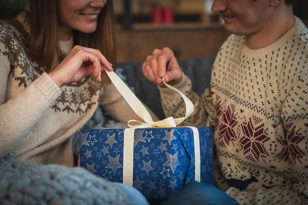 Cute couple opening present