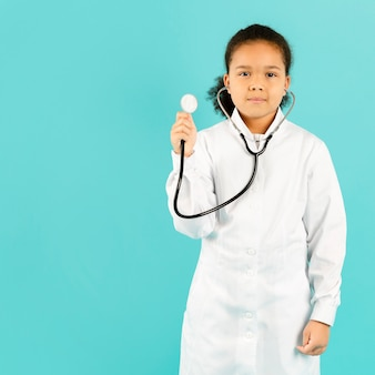 Cute doctor holding stethoscope