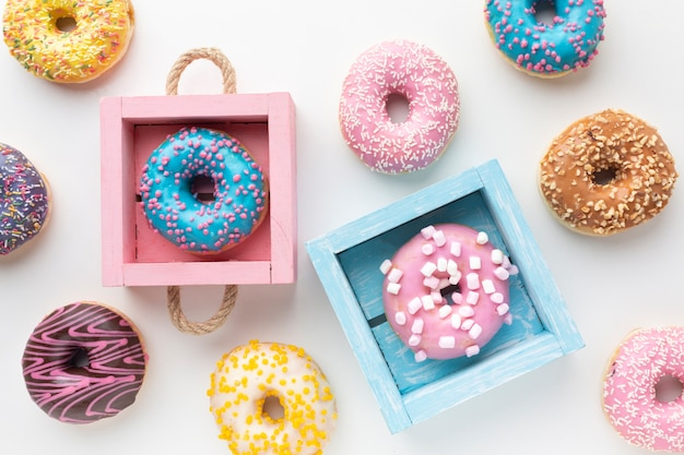 Cute donuts in colorful boxes