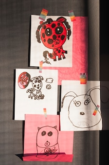 Cute doodles hanging on wall