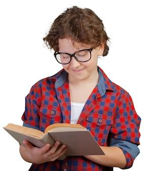 Cute elementary school boy holding book