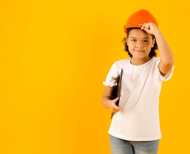 Cute engineer wearing hard helmet