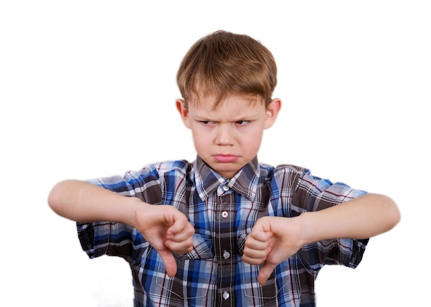 Cute european boy with a gesture dislike and expressed emotion of discontent on his face. isolate on white background