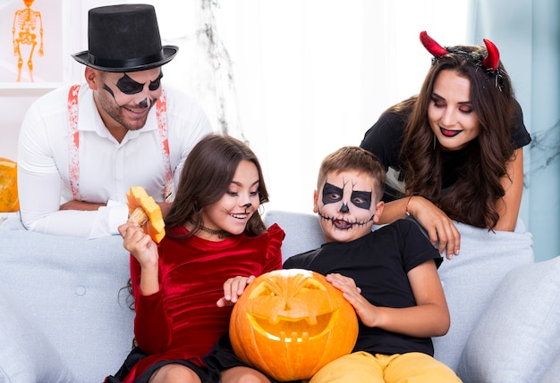 Cute family gathered together for halloween