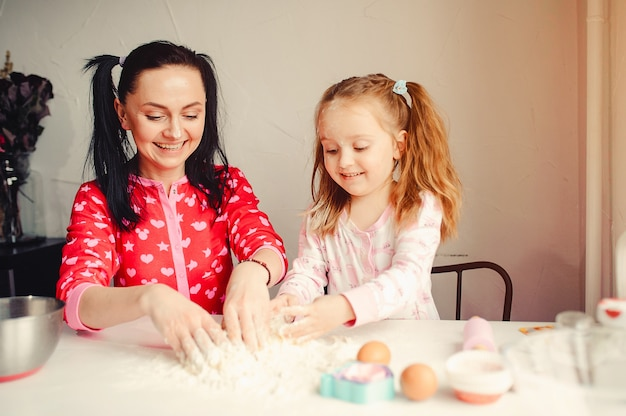 Cute family have fun in a kitchen