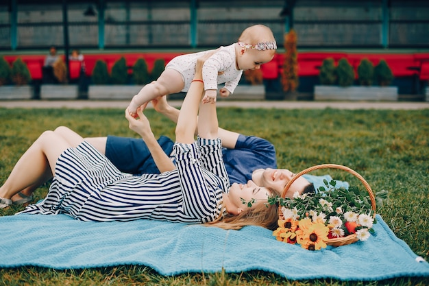 Cute family playing in a summer park