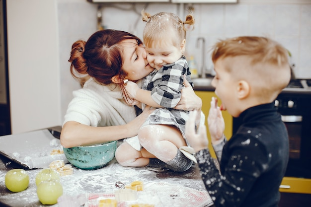 Cute family prepare the breakfest in a kitchen