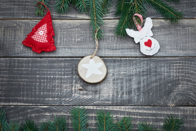 Cute felt decoration on the wood