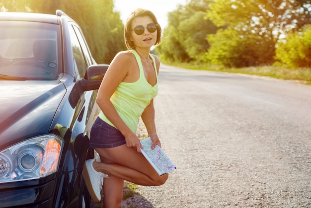 Cute female driver is traveling.