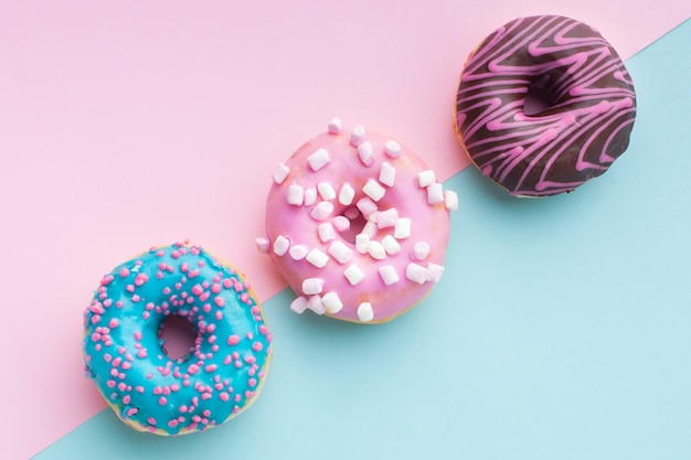 Cute filled donuts in top view