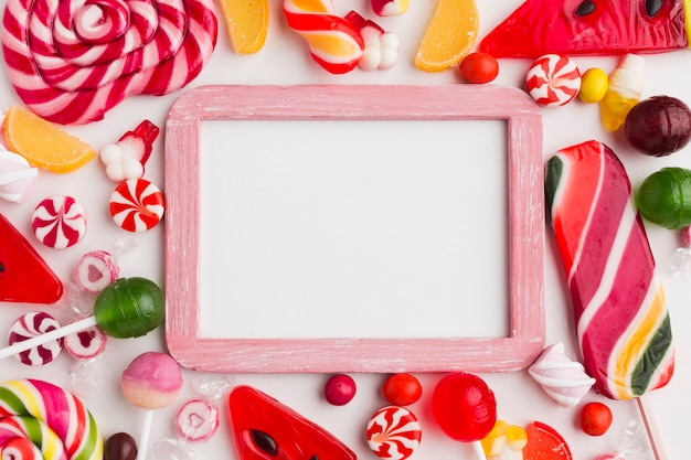 Cute frame with sweets and copy space