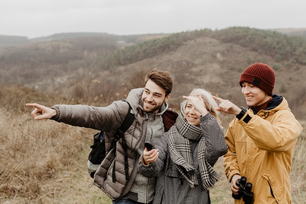 Cute friends pointing at view