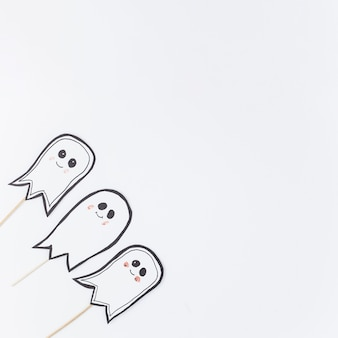 Cute ghosts on sticks prepared for halloween