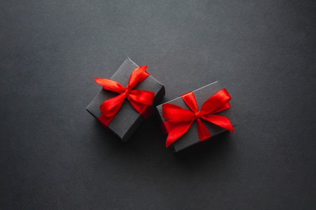 Cute gift boxes on black background