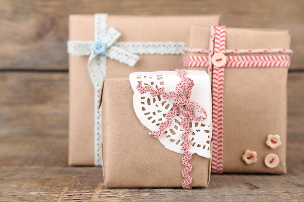 Cute gift boxes on wooden surface