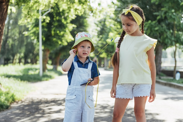 Cute girl and boy listening to music