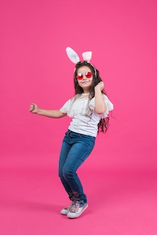 Cute girl in bunny ears dancing