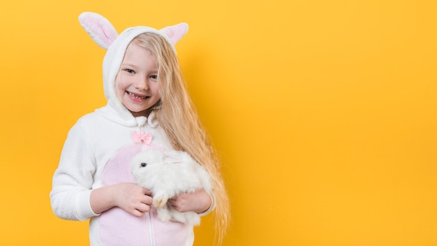 Cute girl in bunny ears with rabbit