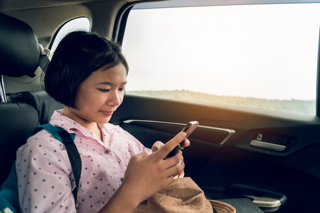 Cute girl in car traveling on holiday
