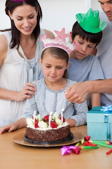 Cute girl celebrating her birthday with her family