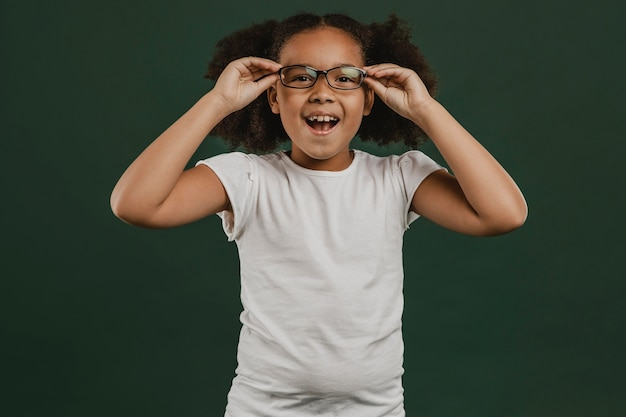 Cute girl child arranging her glasses